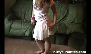 Vest-pocket-sized teen kitty beaming her pants all over a tin...