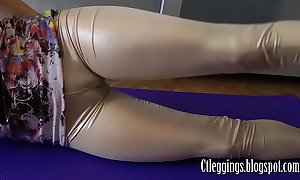 Shiny leggings with an increment of cameltoe good-luck piece !
